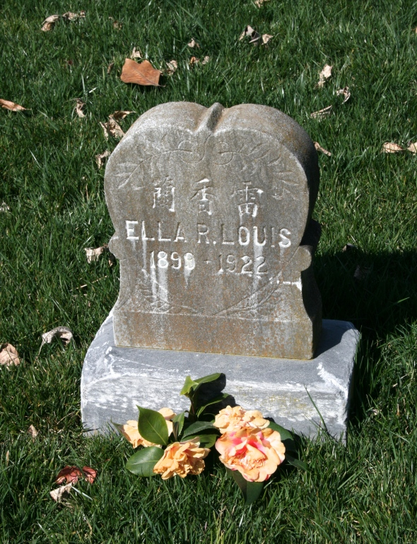 this simple little headstone with roses was a beautiful memorial.
